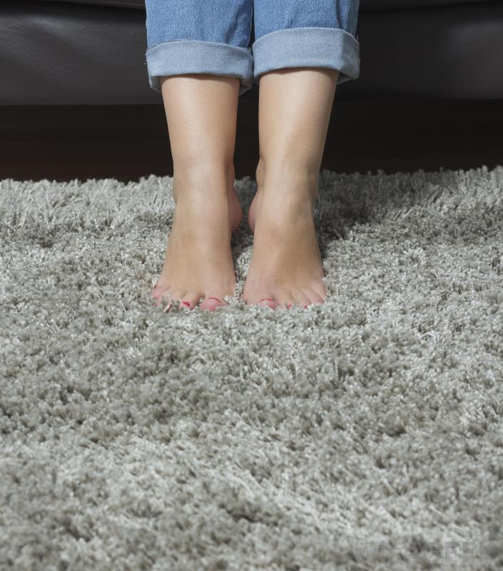 This image has an empty alt attribute; its file name is feet-on-thick-carpet.jpg